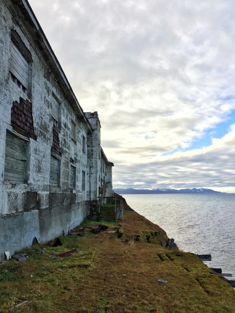 One of the larger buildings in Grumant sitting on the edge of Isfjorden